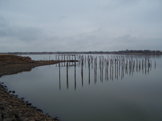 Weathered wooden pilings are all that remains today of a once regal, recreational palace.